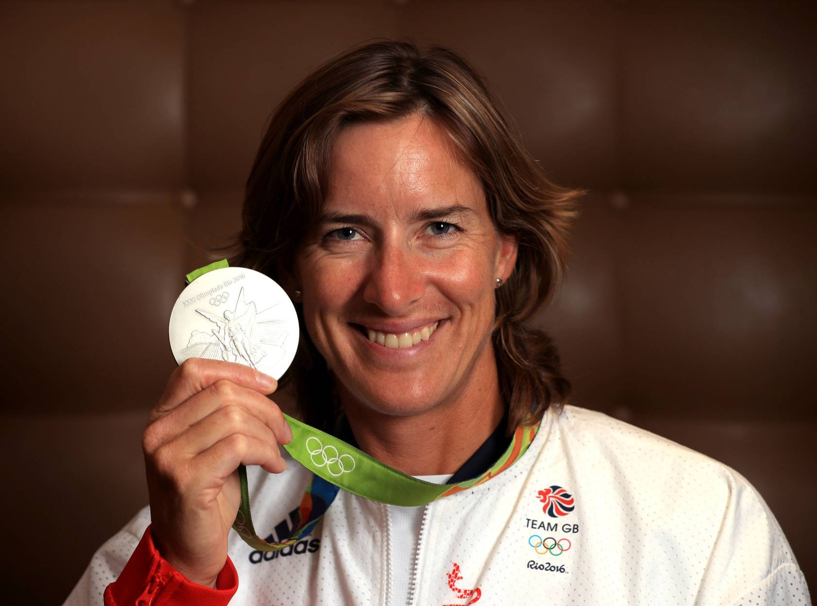 Great Britain's Katherine Grainger poses with her silver medal after a press conference at the Sofitel Hotel, Heathrow Airport. PRESS ASSOCIATION Photo. Picture date: Tuesday August 23, 2016. Team GB arrive back in the UK after finishing second in Rio 2016 Olympic medal table, surpassing their London 2012 medal haul. Photo credit should read: John Walton/PA Wire